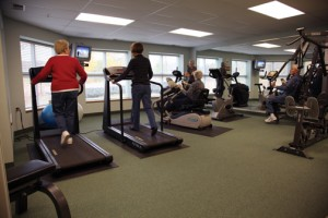 People working out in co-op fitness center