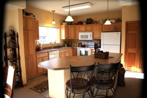 Smaller kitchen with island and chairs