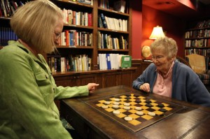 Women playing checkers
